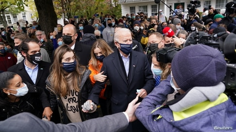U.S. Democratic presidential nominee Joe Biden makes his way through the crowd outside of his childhood home on Election Day in…