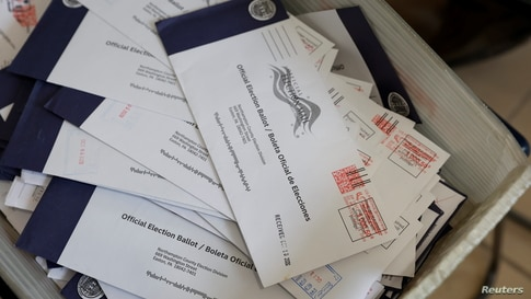 Mail-in ballots are seen at the Northampton County Courthouse on Election Day in Easton, Pennsylvania, U.S., November 3, 2020…