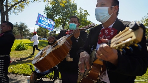 A Mariachi band play outside of a polling site on Election Day in Houston, Texas, U.S. November 3, 2020. REUTERS/Go Nakamura