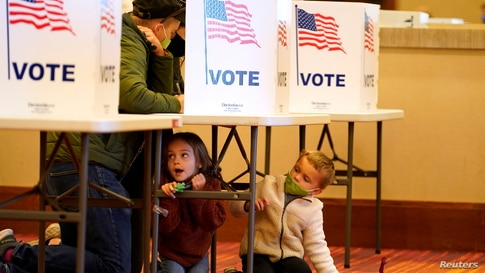People fill out their ballots at a polling center on the Election Day in Jeffersontown, Kentucky, U.S. November 3, 2020. …