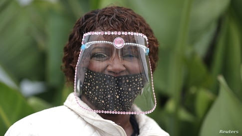 Rosa Russell, 70, wears a face shield decorated with jewels during the 2020 U.S. presidential election, in Santa Monica,…