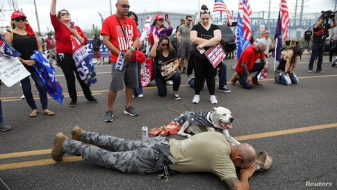 Supporters of U.S. President Donald Trump pray during a protest about the early results of the 2020 presidential election, in…