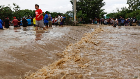 Residents wait to be rescued from a flooded area near Lima, Honduras, Thursday, Nov. 5, 2020. The storm that hit Nicaragua as a…