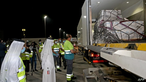 This handout picture provided by Qatar's Government Communications Office (GCO) shows the arrival of shipments of the Pfizer…