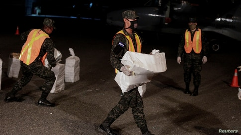 FILE PHOTO: Soldiers carry cocaine packages seized during an operation in the municipality of Brus Laguna, where members of the…