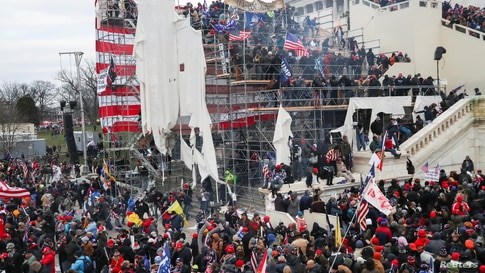 Supporters of U.S. President Donald Trump gather in front of the U.S. Capitol Building in Washington, U.S., January 6, 2021…