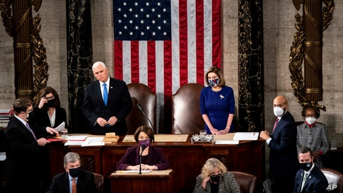 Speaker of the House Nancy Pelosi, D-Calif., and Vice President Mike Pence preside as a joint session of the House and Senate…