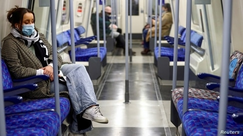 FILE - Commuters travel by underground inside an almost empty train, amid the coronavirus disease (COVID-19) outbreak, in London, Britain, Jan. 5, 2021.