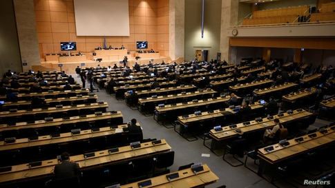 Delegates attend the resuming of a United Nations Human Rights Council session before an urgent debate on allegations of …