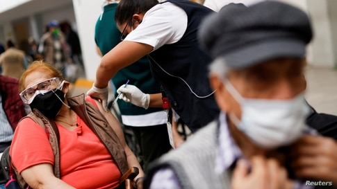 People are administered the Sinovac coronavirus disease (COVID-19) vaccine during a mass vaccination in Ecatepec, state of…