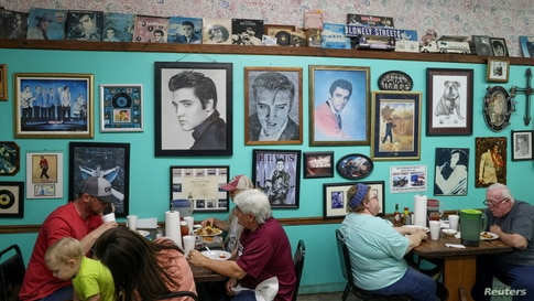 Patrons eat dinner at Pap's Place catfish restaurant, which closed for a time during the coronavirus disease pandemic lockdown,…