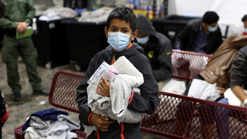 A young migrant waits for his turn to take a shower at the Donna Department of Homeland Security holding facility, the main…