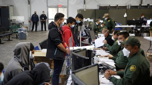 Migrants are processed at the intake area of the Donna Department of Homeland Security holding facility, the main detention…