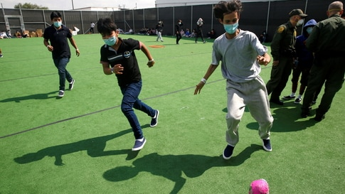 Migrant children play soccer at a small field at the Donna Department of Homeland Security holding facility, the main detention…