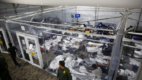 Migrant children rest inside a pod in the Donna Department of Homeland Security holding facility, the main detention center for…