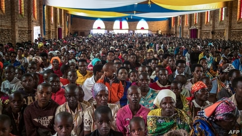 Catholic devotees attend Easter mass at La paroisse Saint Aloys d'Ijenda in Ijenda, Burundi, on April 4, 2021. (Photo by…