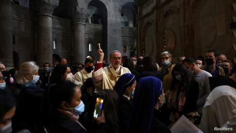 Latin Patriarch of Jerusalem Pierbattista Pizzaballa leads Easter Sunday Mass amid eased coronavirus disease (COVID-19)…