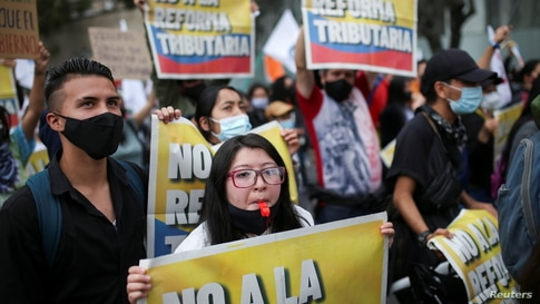 Demonstrators take part in a protest against the tax reform of President Ivan Duque's government in Bogota, Colombia April 28,…