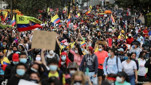 FILE PHOTO: Demonstrators take part in a protest against the tax reform of President Ivan Duque's government in Bogota,…