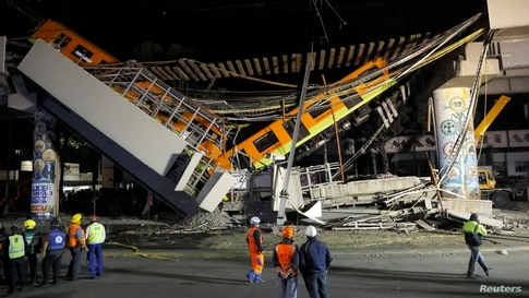 The site where an overpass for a metro partially collapsed with train cars on it is seen at Olivos station in Mexico City,…