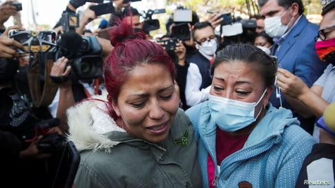 Relatives of the victims arrive at the site where an overpass for a metro partially collapsed with train cars on it at Olivos…