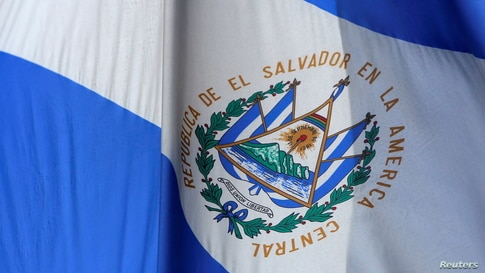 FILE PHOTO: The El Salvador national flag hangs outside the Consulate General of El Salvador in Manhattan, New York City, U.S…
