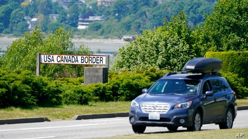 A car heads into the U.S. from Canada at the Peace Arch border crossing Tuesday, June 8, 2021, in Blaine, Wash. The border has…