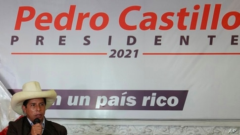 Presidential candidate Pedro Castillo speaks during a press conference at his campaign headquarters in Lima, Peru, Tuesday,…