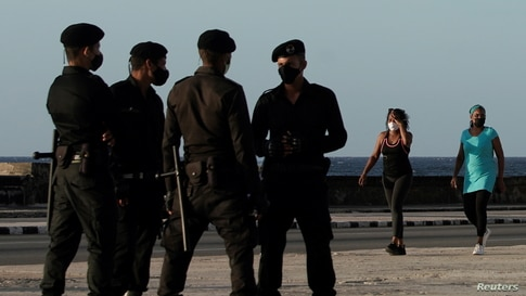 Special forces patrol the seafront Malecon as people pass by in Havana, Cuba, July 16, 2021. REUTERS/Alexandre Meneghini
