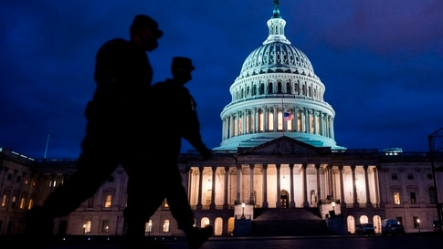 TOPSHOT - Members of the US National Guard patrol at the US Capitol in Washington, DC on January 17, 2021, during a nationwide…