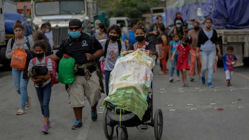 TOPSHOT - Honduran migrants who voluntarely return to Honduras walk in El Florido, Chiquimula, Guatemala on January 19, 2021. -…