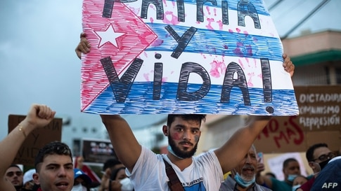 Cuban citizens residing in Dominican Republic take part in a demonstration against the government of the Cuban President Miguel…