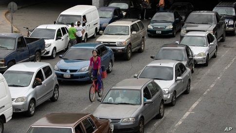 Vehicles line up near a gas station to fill their tanks, in Caracas, Venezuela, Friday, May 29, 2020. Venezuela boasts the…
