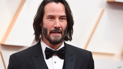 Keanu Reeves arrives at the Oscars on Sunday, Feb. 9, 2020, at the Dolby Theatre in Los Angeles. (Photo by Jordan Strauss…