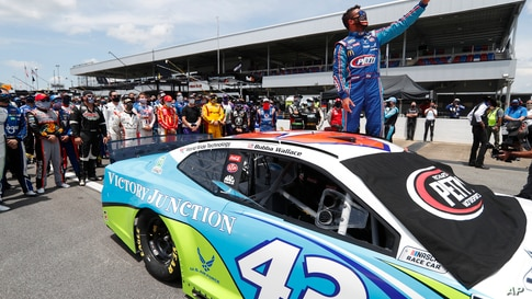 FILE - In this June 22, 2020, file photo, Bubba Wallace takes a selfie of himself and of other drivers who had pushed his car…
