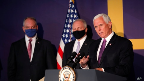 Vice President Mike Pence speaks at a press conference with Louisiana Gov. John Bel Edwards, left, and Rep. Steve Scalise, R-La…