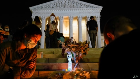 People gather at the Supreme Court Friday, Sept. 18, 2020, in Washington, after the Supreme Court announced that Supreme Court…