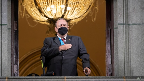 Guatemalan President Alejandro Giammattei wearing a protective face mask as a precaution against the spread of the new…