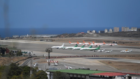 Airplanes parked at Maiquetia Airport after Nicolas Maduro's government cancelled domestic flights and some internacional…
