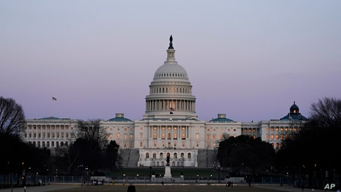 The U.S. Capitol building is shown after sunset Thursday, March 4, 2021, in Washington. (AP Photo/Alex Brandon)