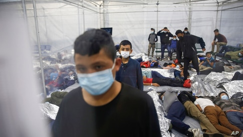 Young children stand as others rest inside a pod at the Donna Department of Homeland Security holding facility, the main…