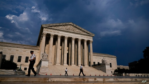 The Supreme Court is seen under threatening skies following a storm in Washington, Wednesday, May 26, 2021. (AP Photo/J. Scott…