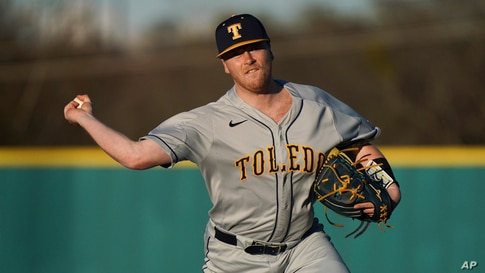 Toledo pitcher Cal McAninch delivers to the plate during an NCAA baseball game against US Upstate on Friday, Feb. 19, 2021, in…