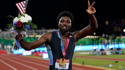Noah Lyles celebrates after winning the final in the men's 200-meter run at the U.S. Olympic Track and Field Trials Sunday,…
