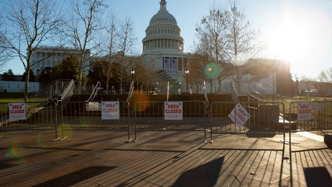 Barricades and signs restrict access on the grounds of the U.S. Capitol building in Washington