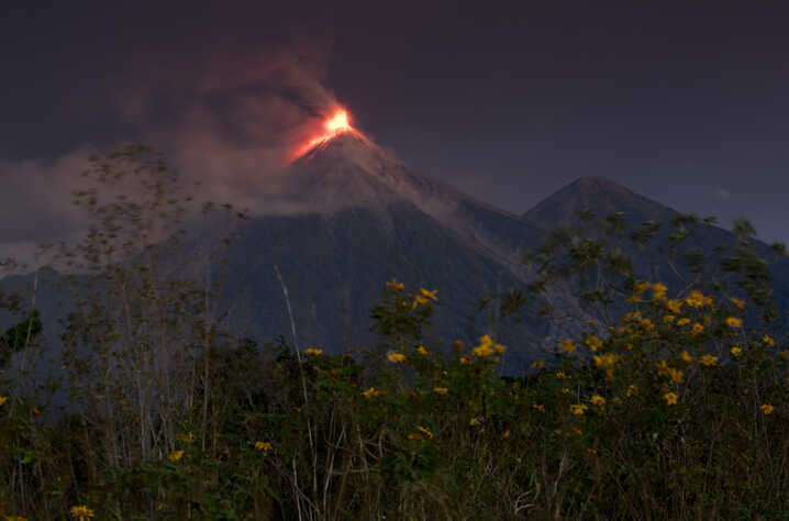 The Volcan de Fuego, or Volcano of Fire, spews hot molten lava from its crater in Escuintla, Guatemala, early Monday, Nov. 19, 2018. Disaster coordination authorities have asked several communities in Guatemala to evacuate and go to safe areas after