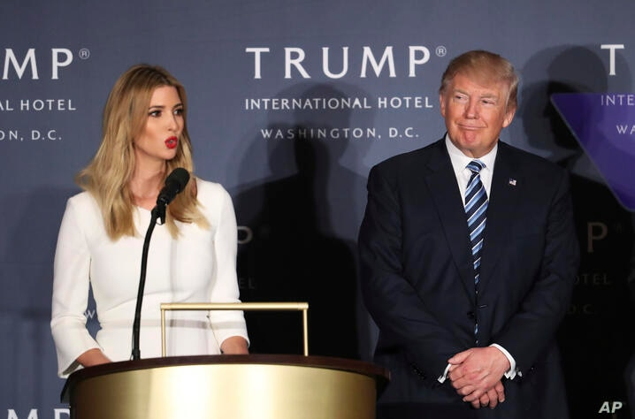 FILE - Republican presidential candidate Donald Trump listens as his daughter Ivanka Trump speaks during the grand opening of Trump International Hotel in Washington.
