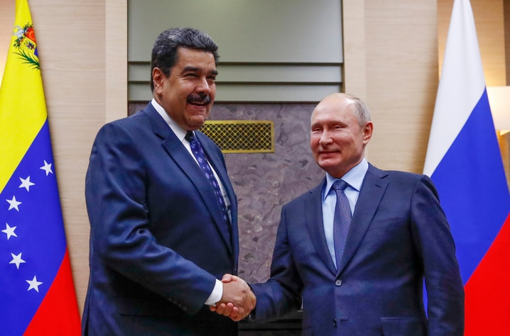 Russian President Vladimir Putin, right, shakes hands with his Venezuelan counterpart Nicolas Maduro during their meeting at the Novo-Ogaryovo residence outside in Moscow, Russia, Dec. 5, 2018. (Maxim Shemetov/Pool Photo via AP)