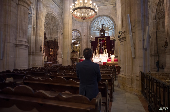 A man attends Easter mass celebrated by Spanish priest Salvador behind closed doors at the Colegiata de Santa Maria la Mayor in…