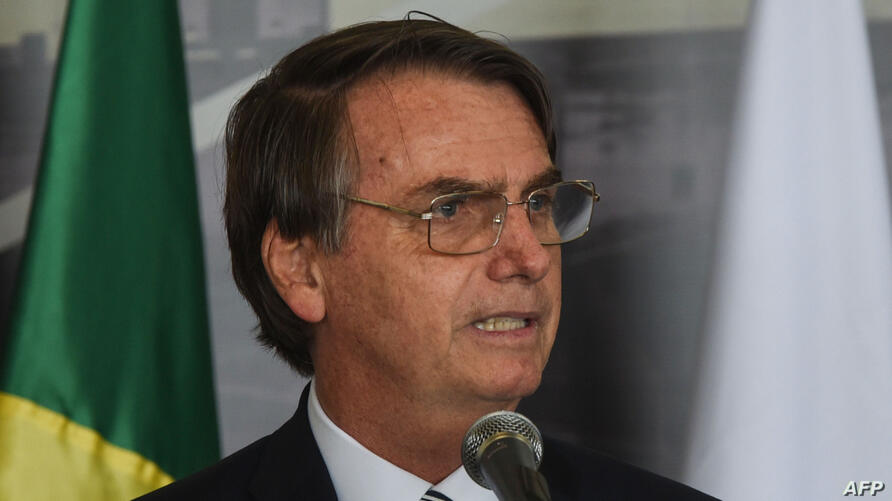 Brazil's President Jair Bolsonaro delivers a speech during the inauguration of the new Director of the Brazilian side of Itaipu binational hydroelectric dam, former Brazilian Defense Minister and Army General Joaquim Silva e Luna, Feb. 26, 2019 in Itaipu,